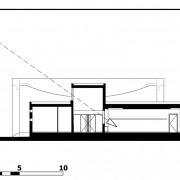 Coupe transversale de l'école de Vieilley (25) montrant l'éclairage en second jour des salles de classes (Quirot-Vichard - architectes - 2004).