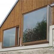 Huisserie de fenêtre de la réhabilitation de la ferme des marcassins (70) (Amiot-Lombard - architectes) photographe: Nicolas Waltefaugle.